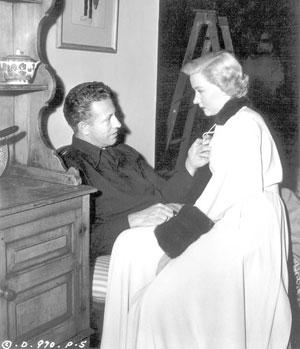 "<a class=""taxInlineTagLink"" id=""PECLB003493"" title=""Nicholas Ray"" href=""/topic/entertainment/nicholas-ray-PECLB003493.topic"">Nicholas Ray</a> directs his wife, Gloria Grahame, in the 1950 noir film ""In a Lonely Place."""