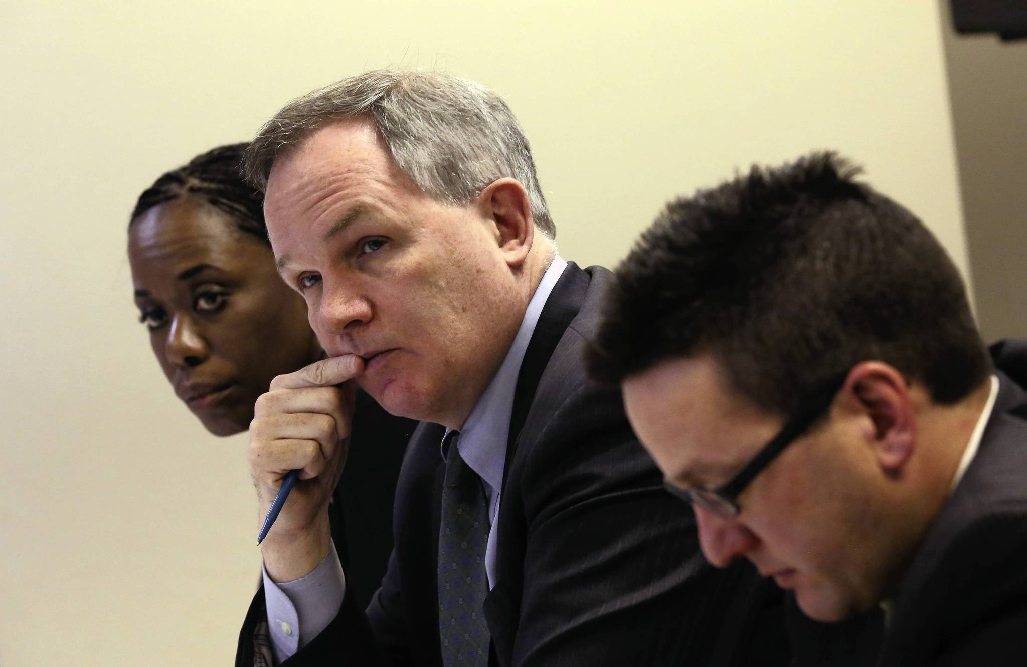From left, Carole Brown, Patrick Fitzgerald and Nick Palmer, members of the Northeastern Illinois Public Transit Task force, listen at a meeting on Monday in Chicago.