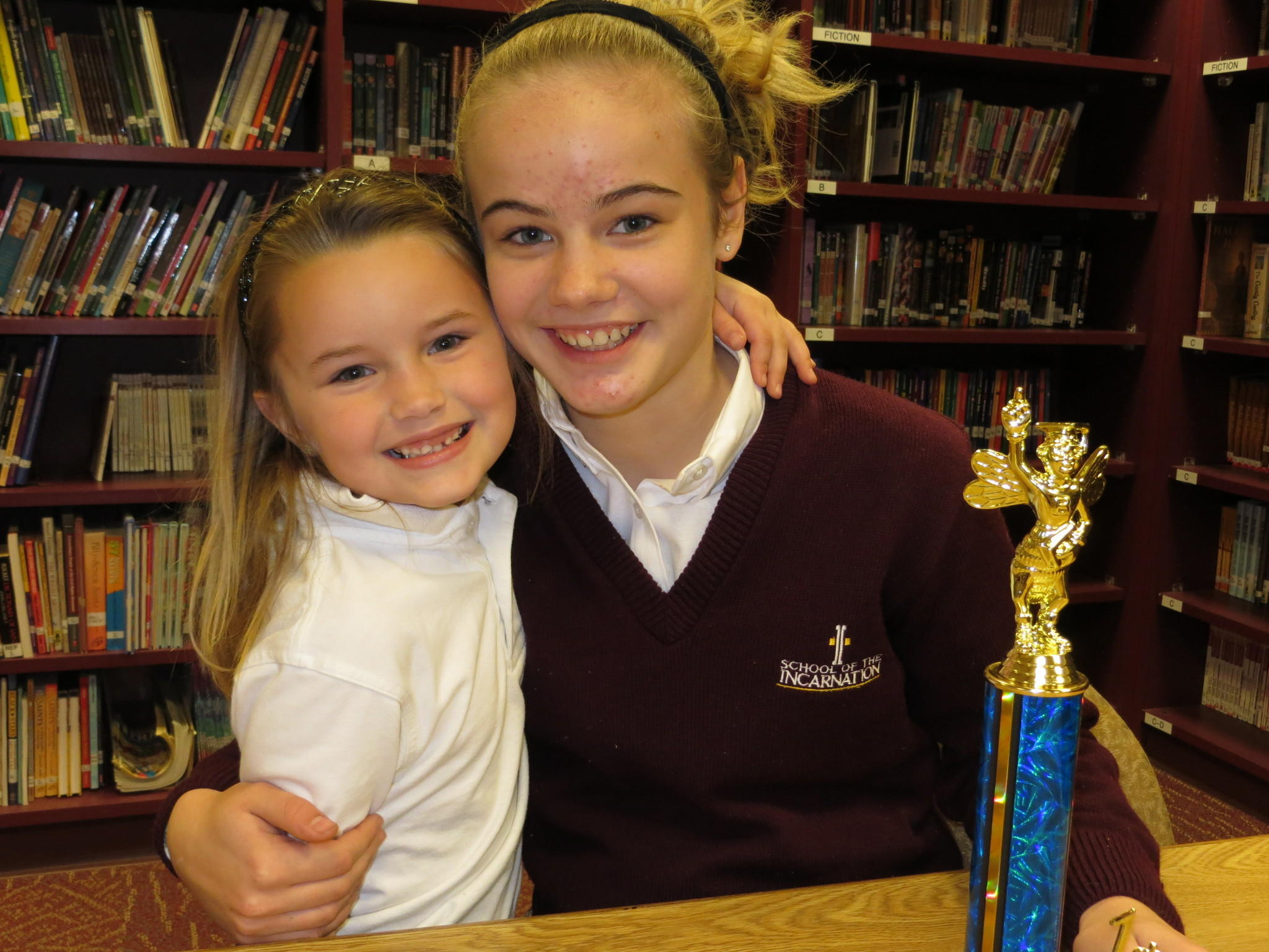 Isabelle Simmons and younger sister Alexandra, also a School of the Incarnation student. Isabelle was the champion of the 26th annual Anne Arundel County Spelling Bee and will now represent the county at the Scripps National Spelling Bee in Washington, D.C.