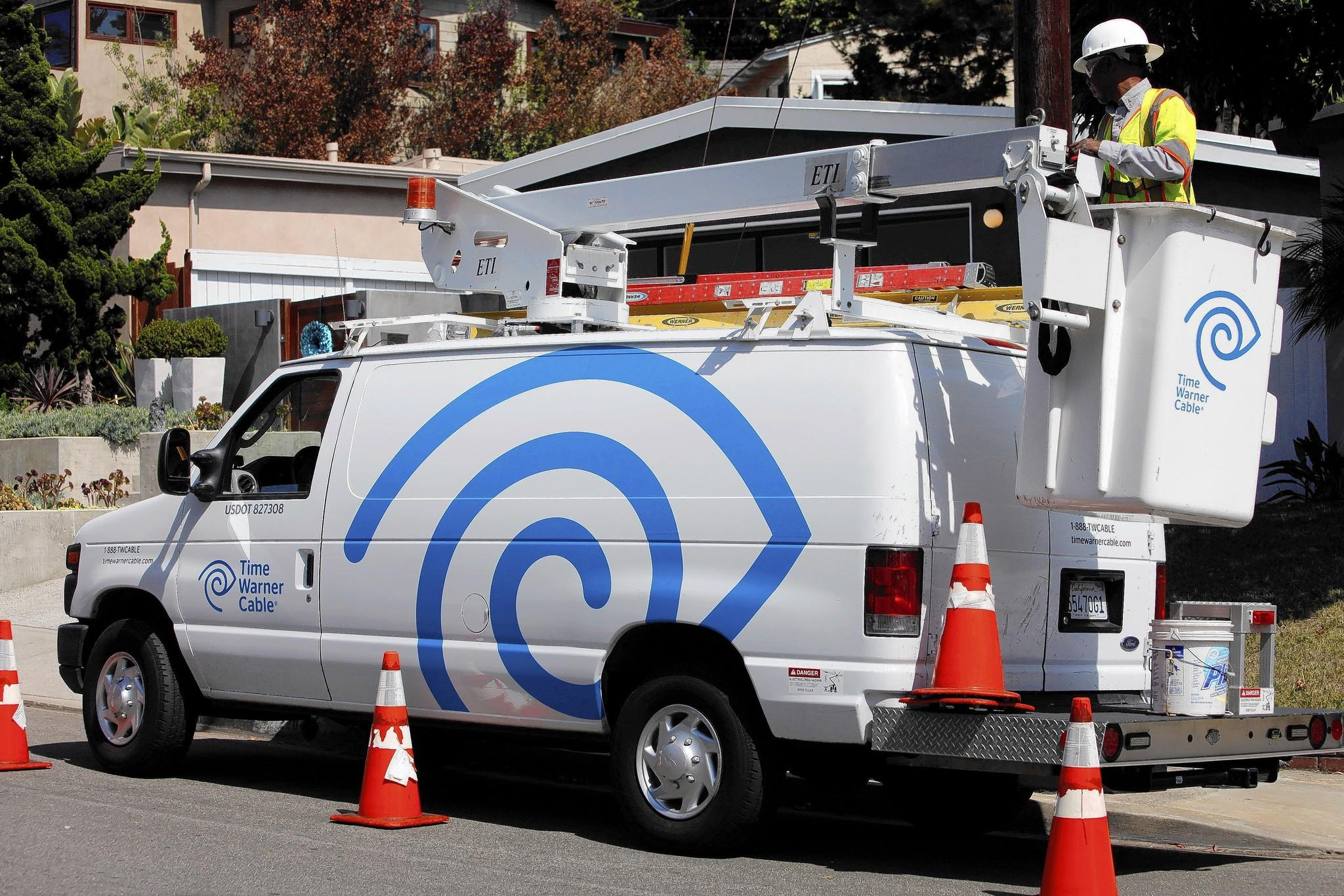 Time Warner Cable has just sent out notices of its latest rate hikes, which take effect with the next bill. As usual, the company says higher prices were unavoidable. Above, a TWC field technician in Manhattan Beach last year.