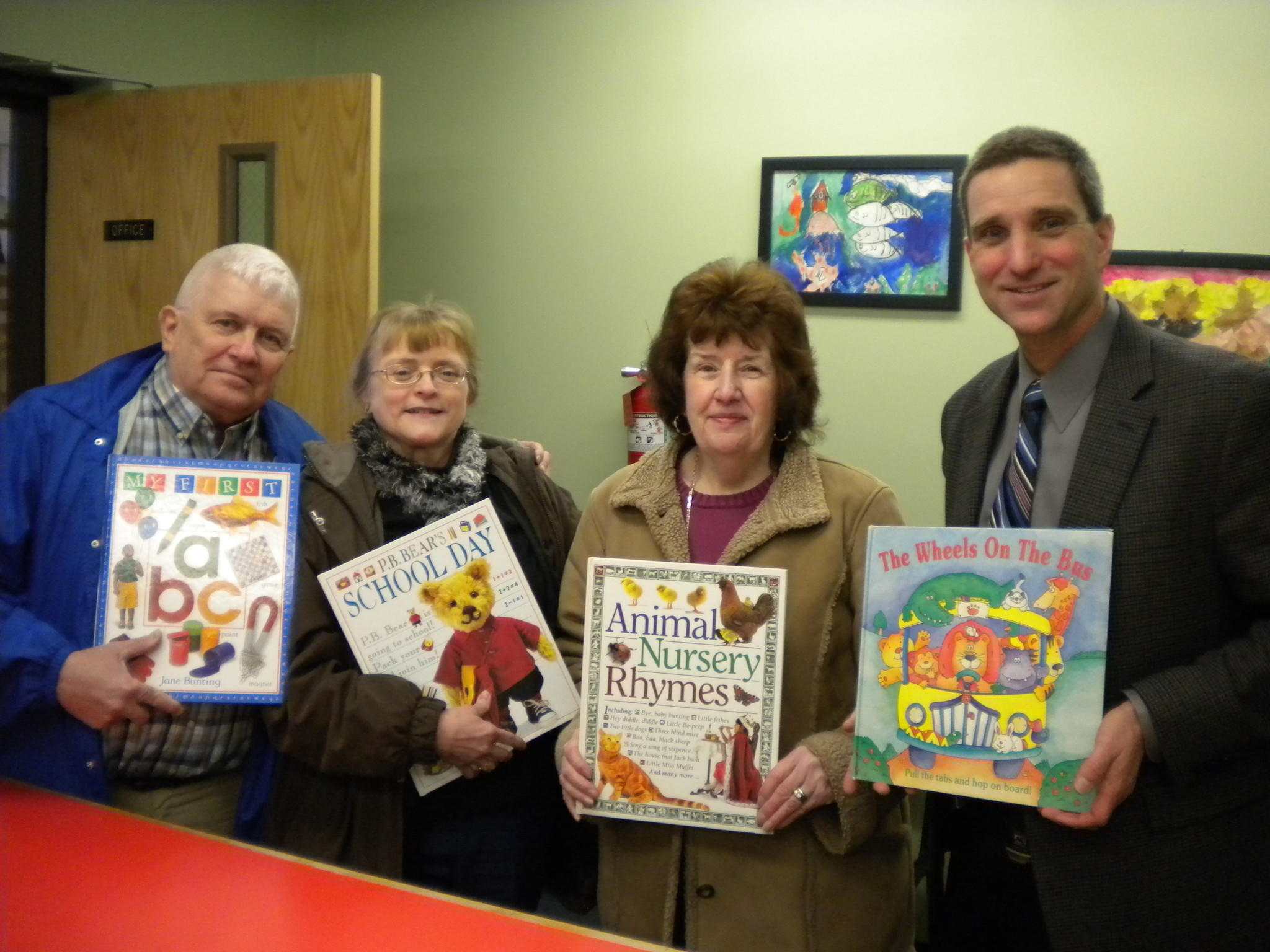 From left to right: Richard Czyz, Mary Sersanti and Sharon Czyz, Bountiful Books co-chairmen, and Troy C. Hopkins, principal, Ashford Elementary School.