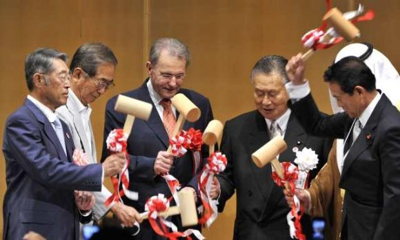 IOC president Jacques Rogge (3rd from left) and joins in the ceremonial breaking of a Sake bottle to mark the 100th anniversary of Japan's Olympic Committee.  The Japanese announced a 2020 Olympic bid as part of the centenary.