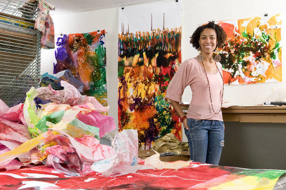 Asante stands with some of her recent work.
