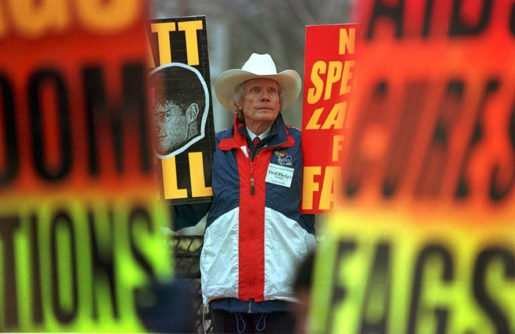 Fred Phelps, founder of the Westboro Baptist Church, stands in 1999 outside the courthouse in Laramie, Wyo., during the trial over the killing of Matthew Shepard.