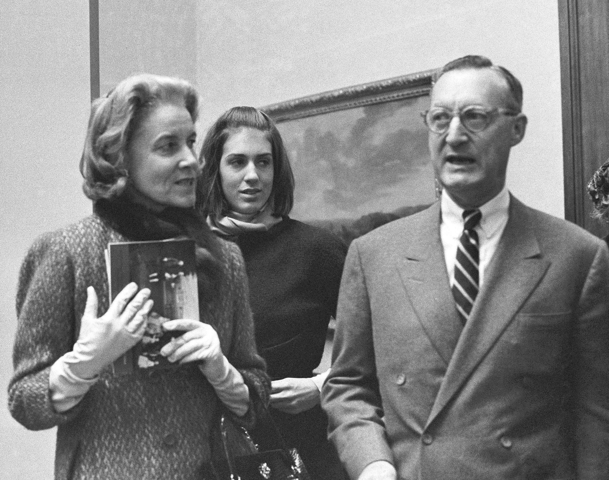 Paul Mellon, his wife, Rachel Bunny Mellon, and stepdaughter Eliza Lloyd at a preview of the Mellons' collection of English Art at the Royal Academy in London on Dec. 11, 1964.