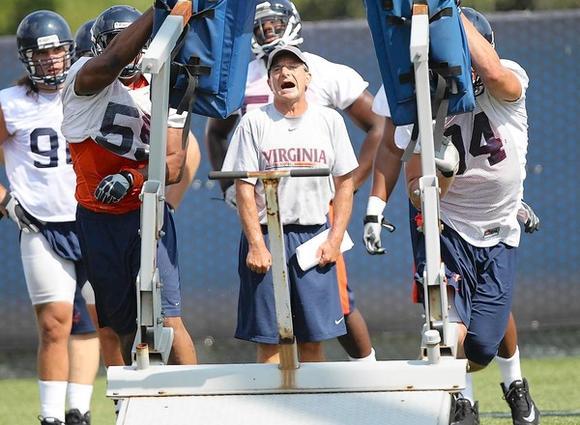 Virginia defensive coordinator Jim Reid is working to challenge his players more