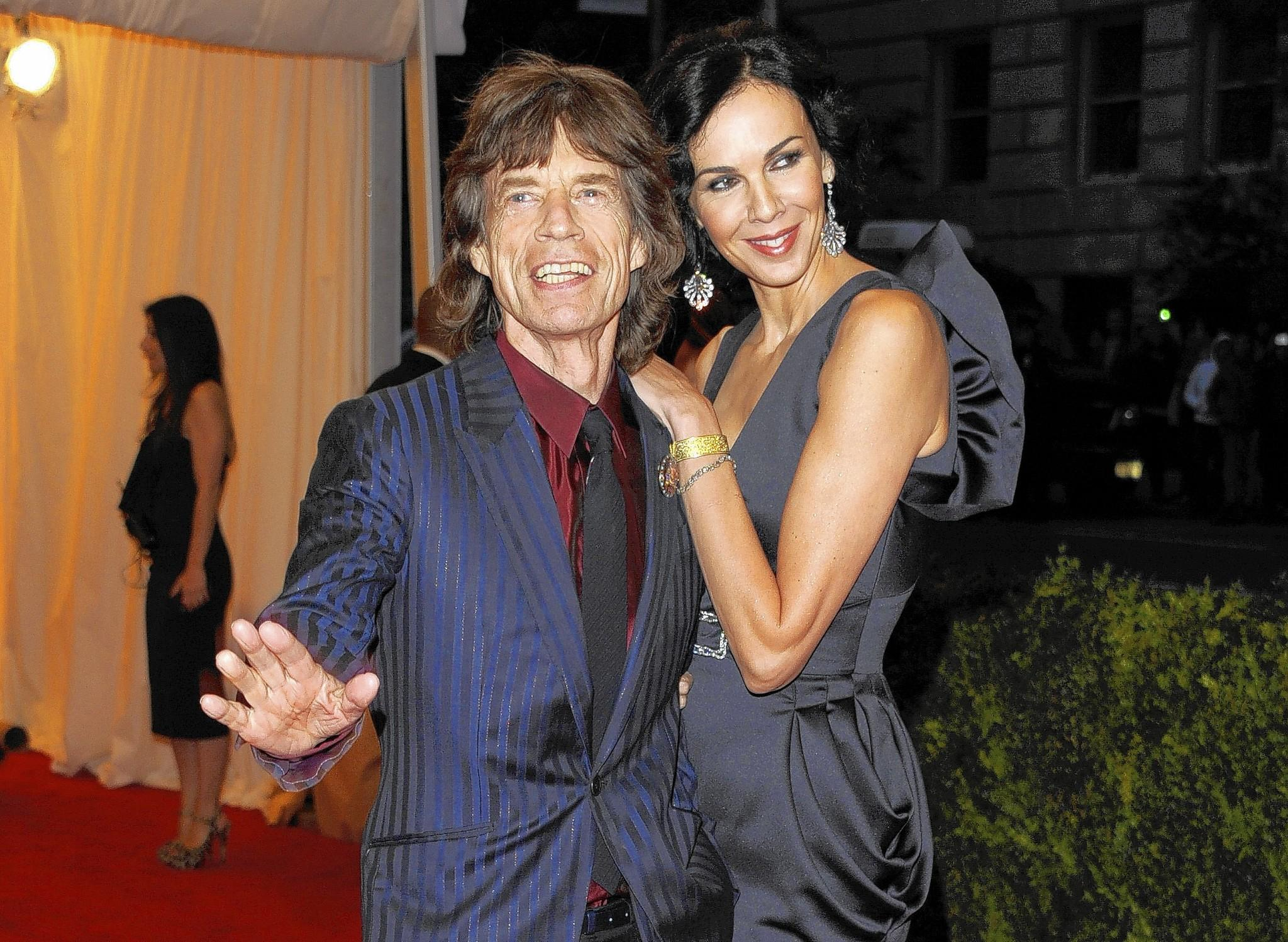 Rolling Stones singer Mick Jagger, left, and L'Wren Scott at a Metropolitan Museum of Art Costume Institute gala benefit in May 2012. The designer was found dead Monday in her New York City apartment.