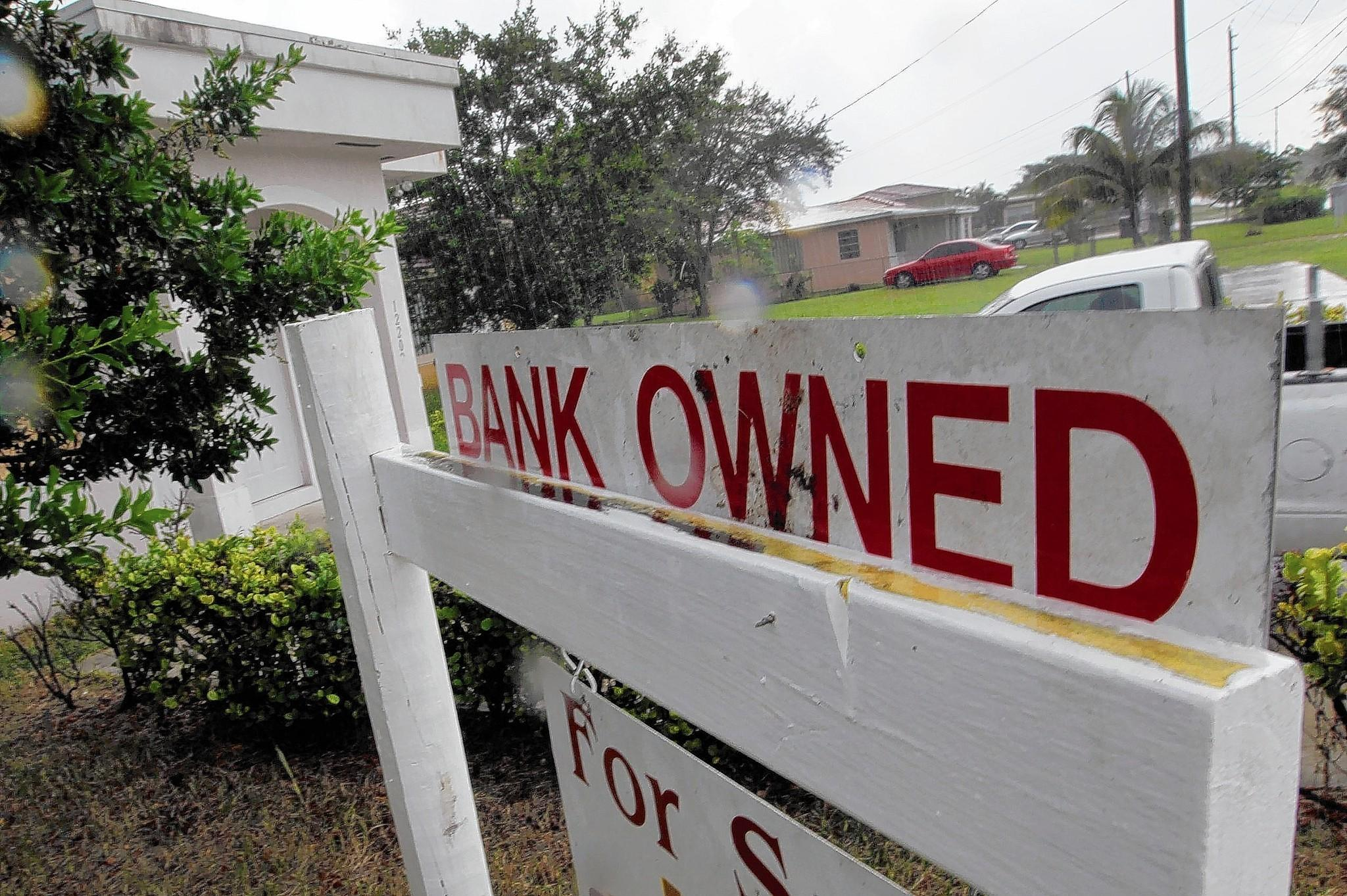 Ocwen broke state law by improperly denying loan modifications, failing to honor modifications granted by prior servicers and charging unauthorized fees, according to the California Department of Business Oversight. Above, a foreclosed home in Miami in 2011.