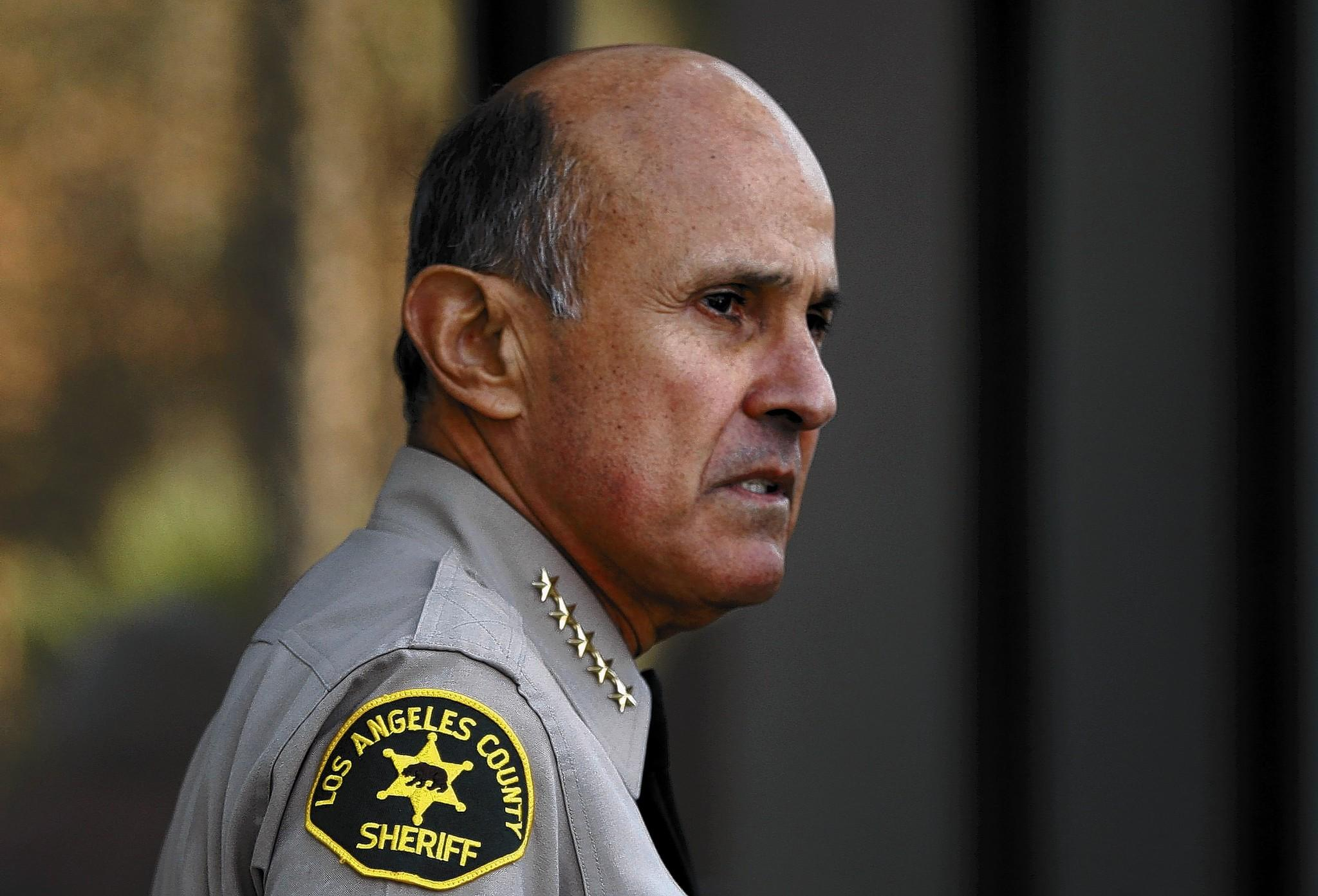 L.A. County Sheriff Lee Baca, seen here speaking to reporters last month, announced his resignation Tuesday. Baca had planned on running for a fifth term as sheriff.