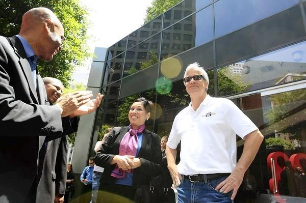 "JPMorgan Chase Chairman Jamie Dimon, right, greets employees at a new branch at 888 W. 6th St. [For the Record: An earlier version of this caption spelled his name ""Damon.""]"