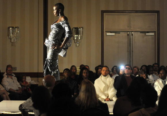 A model wears a dress by LT Dickens Designs, a Baltimore-based designer, during a Baltimore Fashion Week runway show in Towson.
