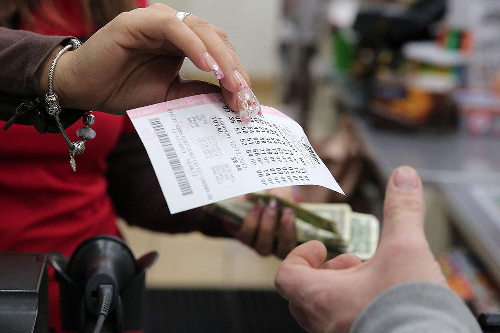 Customers purchase lottery tickets in December at the 7-Eleven near the intersection of South Wabash Avenue and East Madison Street in Chicago in December.