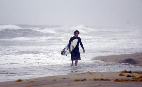 Surfer Chris Battalene walks at Delray Beach
