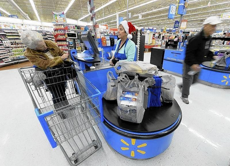 Customers shop at the Wal-Mart Supercenter in the Porter Ranch section of Los Angeles.