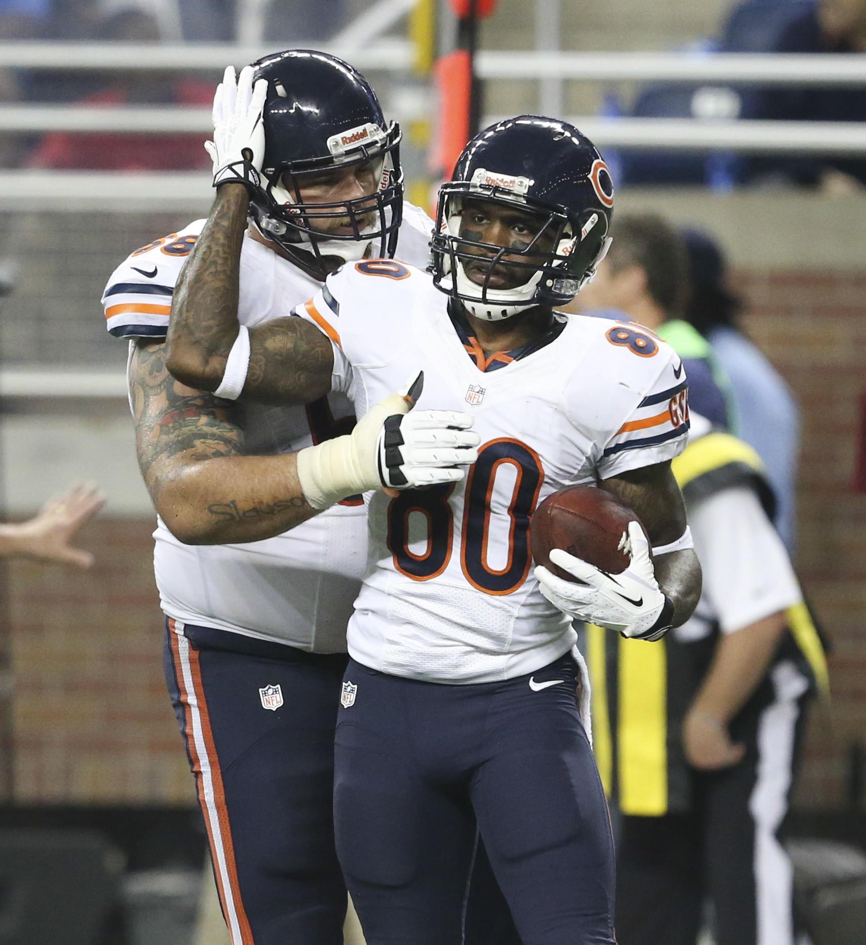 Bears wide receiver Earl Bennett (80) celebrates a touchdown with guard Matt Slauson.