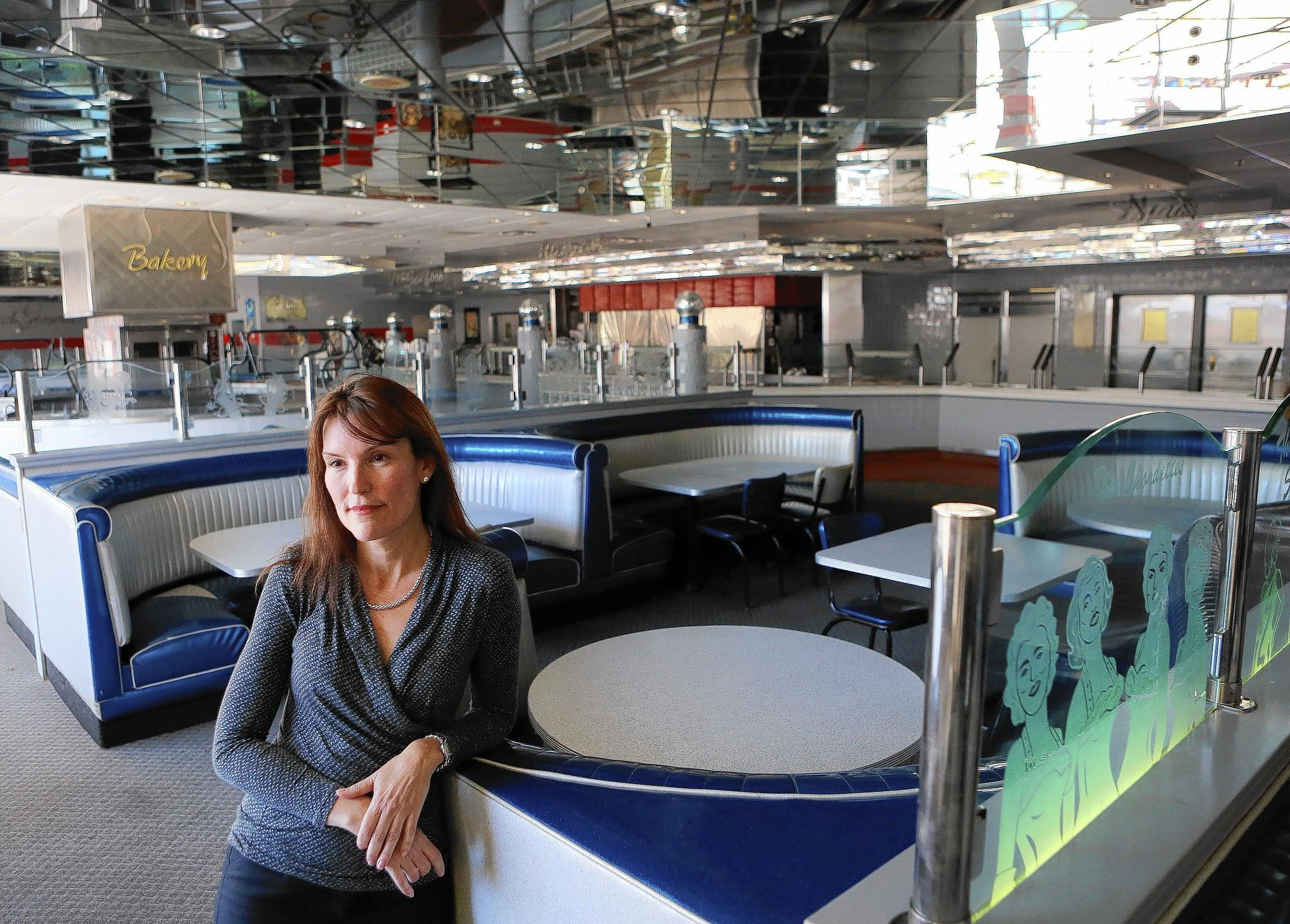 Dianna Chane stands in the now closed Angel's Lobster and Seafood Buffet inside of the Travelodge that she once owned in Kisimmee on March 13, 2013. (Jacob Langston/Orlando Sentinel)