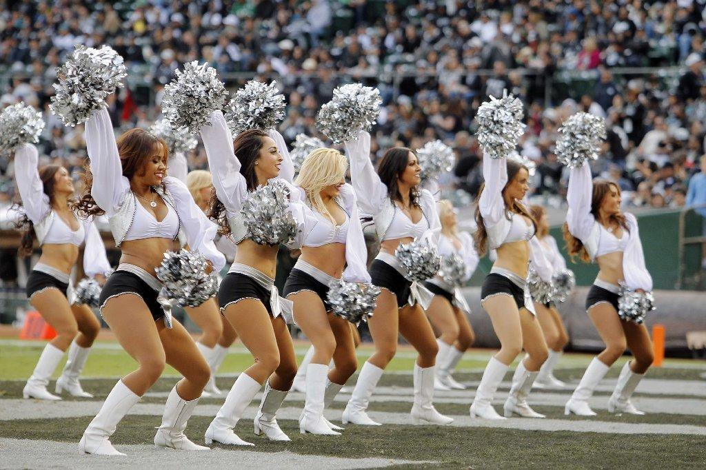 The Raiderettes perform during a timeout between the Philadelphia Eagles and the Oakland Raiders on Nov. 3, 2013, at the Coliseum in Oakland. Two of the cheerleaders are involved in a lawsuit against the team.