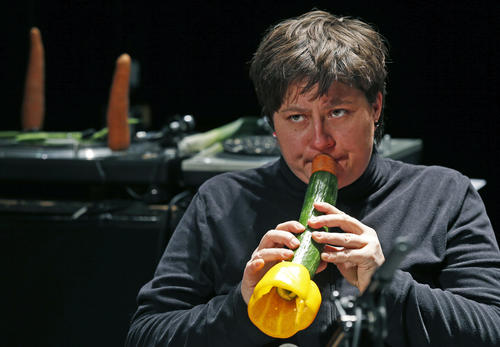 Austrian musician Ingrid Schlogl, who is a member of the Vegetable Orchestra, performs with an instrument made from vegetables during a sound check before a concert in Haguenau, eastern France, January 15, 2014.