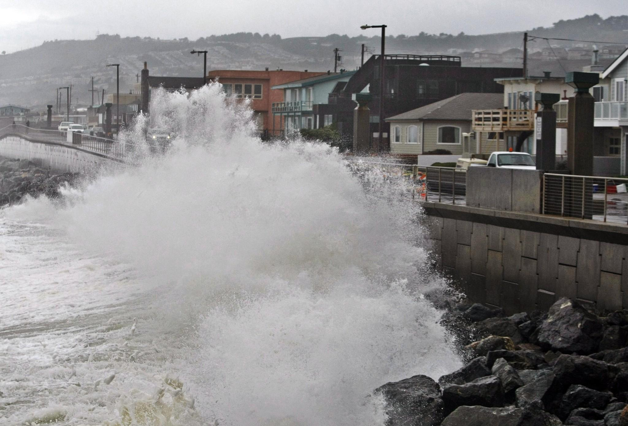 A wave pounds the Pacifica, Calif., coastline during a storm. A new U.S. government website will provide data sets of sea level rise and coastal flooding.