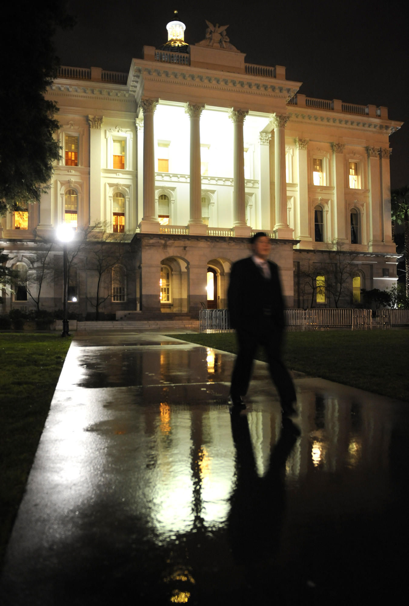 A pedestrian walks out of the State Capitol building in Sacramento. Last month, the Democrats lost their supermajority in the Senate when they were hit with the double-whammy departures of Sen. Roderick Wright of Inglewood, who took a paid leave of absence following his conviction on perjury and voter fraud charges, and Sen. Ronald Calderon of Montebello, who also took a paid leave after he was indicted on federal bribery and corruption charges.