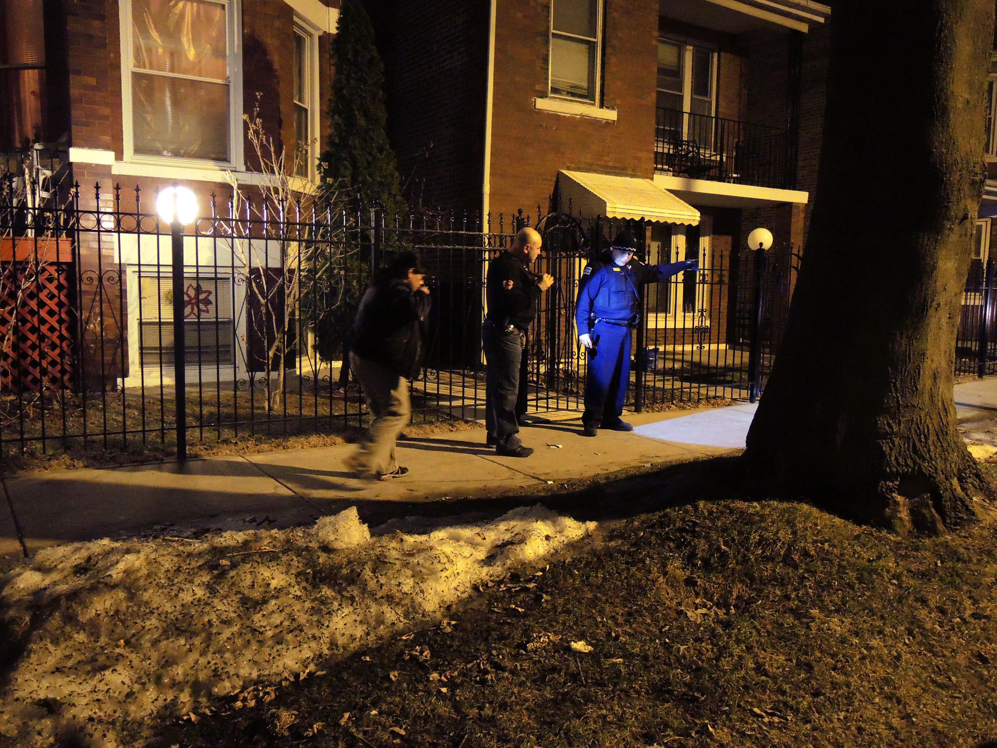Police investigate a Little Village crime scene where a 21-year-old man was shot.
