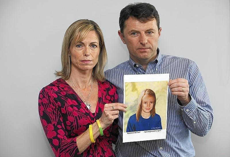 Kate and Gerry McCann pose with a computer generated image of how their missing daughter Madeleine might look in 2012.
