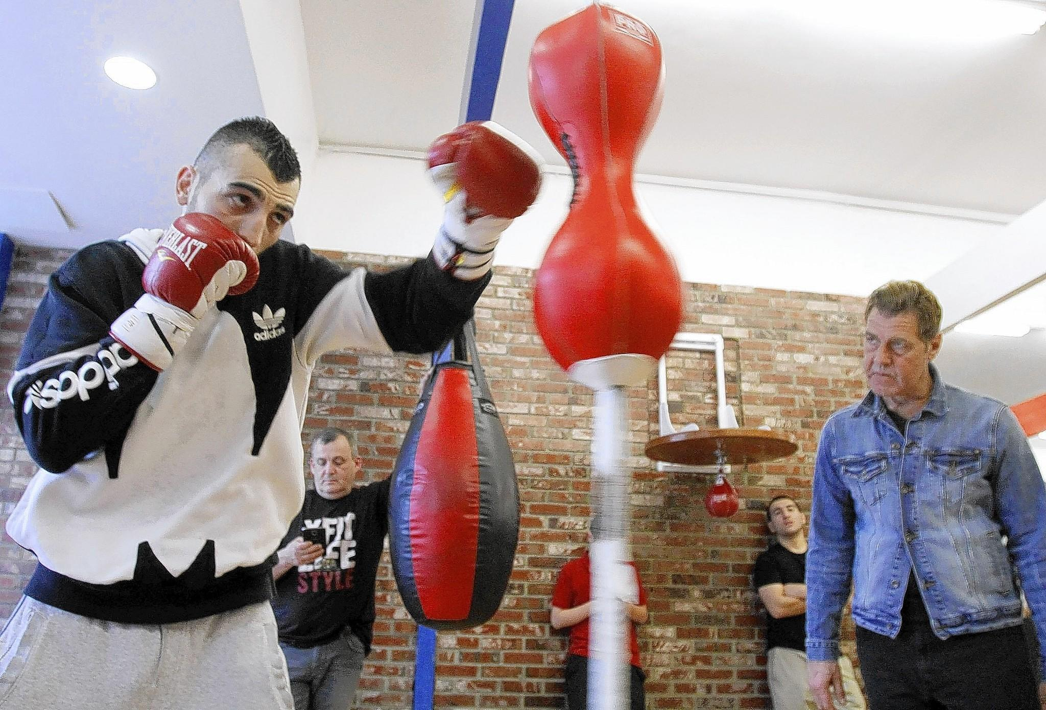 With trainer Joe Goosen keeping a close watch at right, Glendale boxer Vanes Martirosyan trains at Ten Goose Boxing gym in Van Nuys on Tuesday, March 11, 2014. Martirosyan is preparing for an upcoming fight against Mario Alberto Lozano on Friday, March 21, 2014.