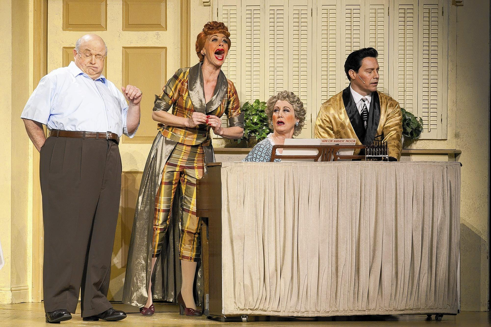 "Kevin Remington, as Fred Mertz, left, Sirena Irwin, as Lucy Ricardo, Joanna Daniels, as Ethel Mertz and Bill Mendieta, as Ricky Ricardo perform at the Segerstrom Center for the Arts in ""I Love Lucy Live on Stage"" on Tuesday."