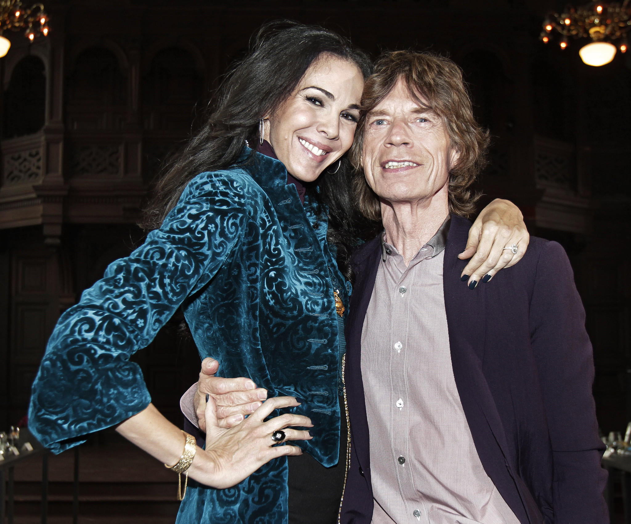 Designer L'Wren Scott is shown with her longtime boyfriend, the Rolling Stones' Mick Jagger. Scott was found dead in New York on Monday.