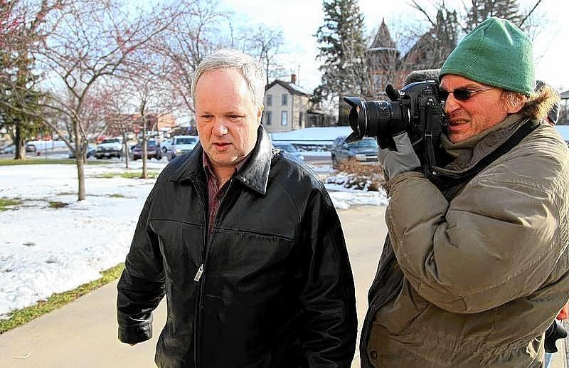 William Melchert-Dinkel is photographed by a news cameraman as he walks to the Rice County Courthouse to enter a not guilty plea in a case accusing him of aiding suicide in the deaths of an English man and Canadian woman in 2010.