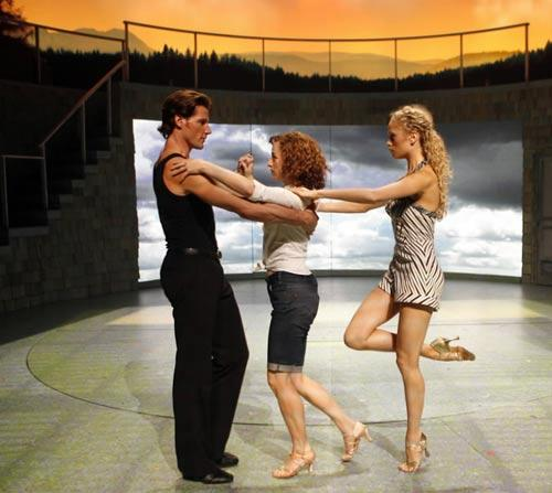 "Josef Brown, from left, playing Johnny Castle, Amanda Leigh Cobb, playing Baby, and Britta Lazenga, playing Penny, dance during a rehearsal for the Chicago production of a pre-Broadway tour of ""Dirty Dancing"" at the Cadillac Palace Theatre, in Chicago."