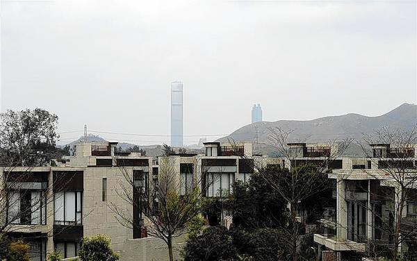 Skyscapers in Shenzhen across mainland China's border are seen behind houses at a luxury estate in Hong Kong