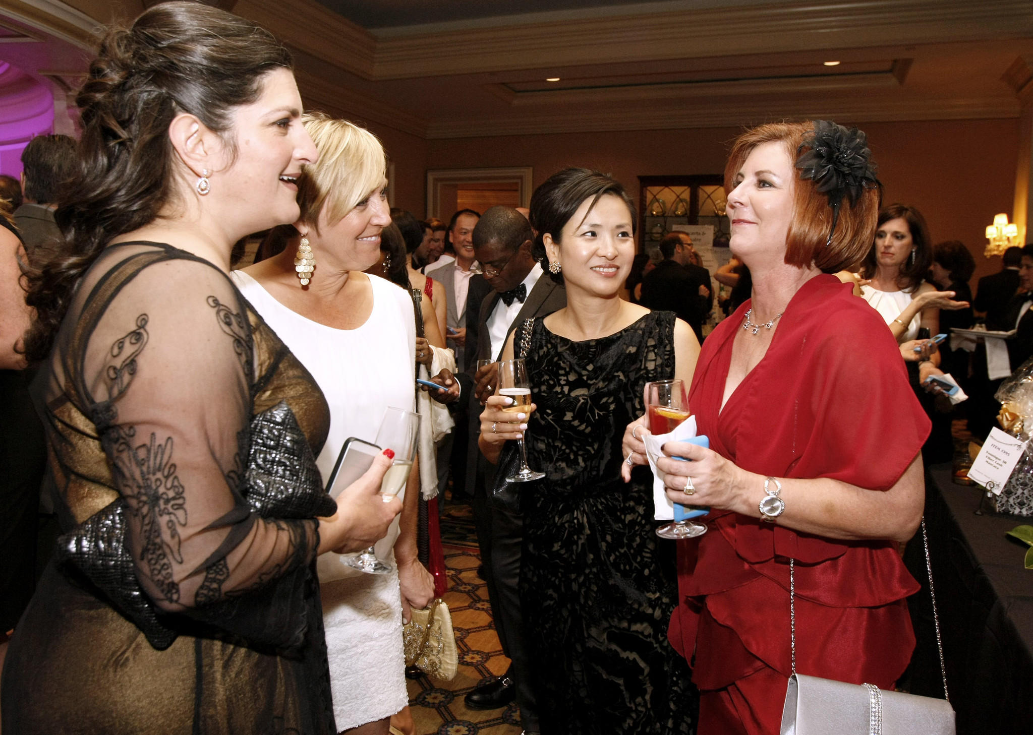 Soo Choi, second from right, and Dale Storz, right, chat with friends at the La Cañada Flintridge Educational Foundation 23rd Annual Spring Gala at the Langham Huntington in Pasadena on Saturday, March 15, 2014.
