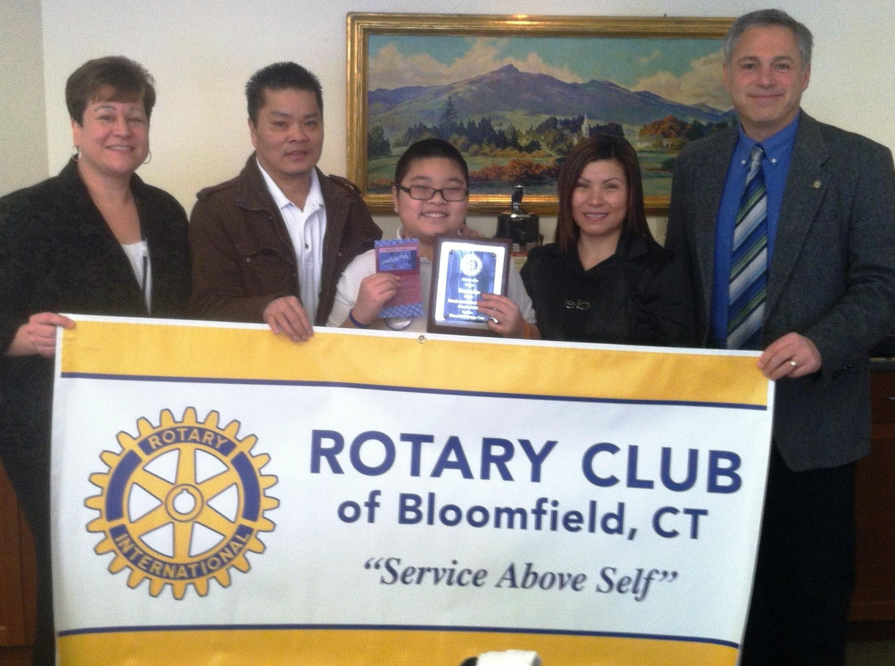 From left to right: Tracy Youngberg, principal Carmen Arace Intermediate School; Lua Van Dang, Danny's father; Danny Le; Christina Le, Danny's mother; Mark Weisman, president Bloomfield Rotary.
