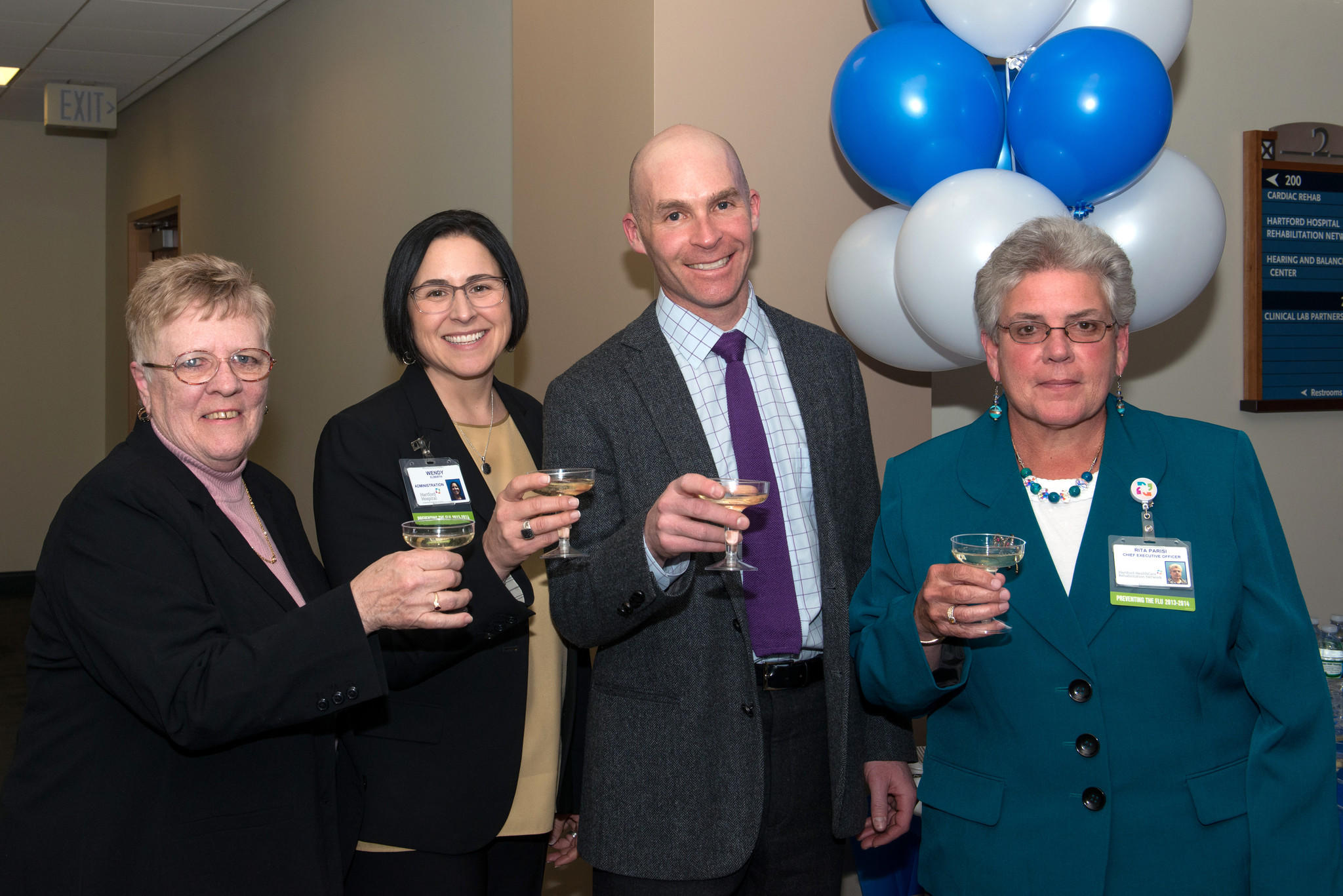 From left to right: Dizzy Clinic patient Karen Mooney; Wendy Elberth, vice president, administration at Hartford Hospital; Dr. Marc Eisen; Rita Parisi, president of Hartford Healthcare Rehabilitation Network & vice president of Hartford Healthcare.