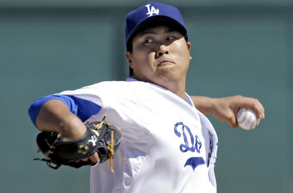 Dodgers starting pitcher Hyun-Jin Ryu delivers a pitch -- is it his wicked changeup? -- against the Colorado Rockies in during an exhibition game last week.