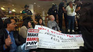 Bank protesters arrested after trying to cash $673-billion check