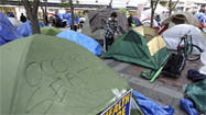 Occupy Seattle protests beset first by rain, now by loss of tents