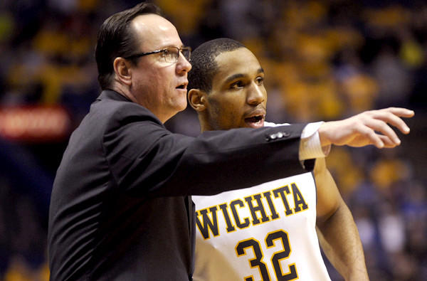 Wichita State Coach Gregg Marshall discusses strategy with Tekele Cotton against Indiana State in the Missouri Valley Conference tournament championship game.