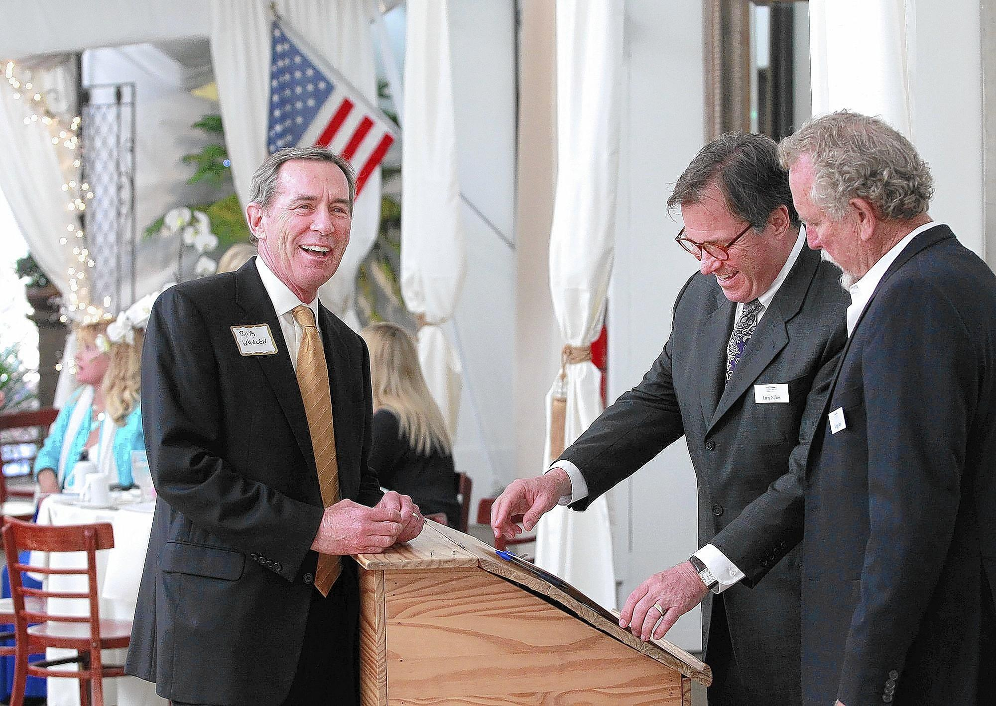 Laguna Beach Mayor Pro Tem Bob Whalen, Chamber president Larry Nokes, and Gregg Abel, who delivered invocation, left to right, chat before beginning the 26th annual Laguna Beach Chamber of Commerce Leadership Luncheon at Tivoli Too on Tuesday.