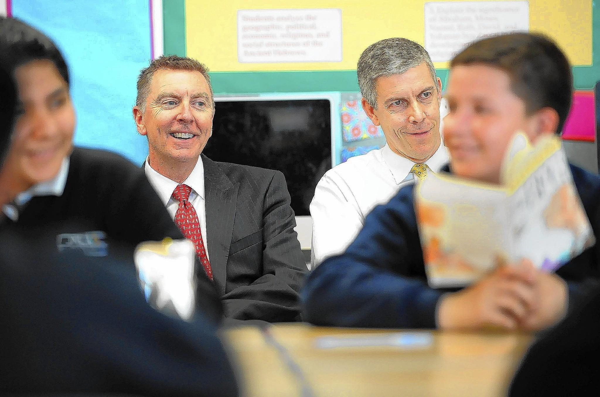 L.A. Unified Supt. John Deasy, left, and U.S. Secretary of Education Arne Duncan listen to a reading class in Los Angeles.