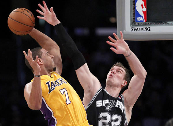 Spurs center Tiago Splitter looks to block a shot by Lakers forward Xaiver Henry in the first half Wednesday night at Staples Center.