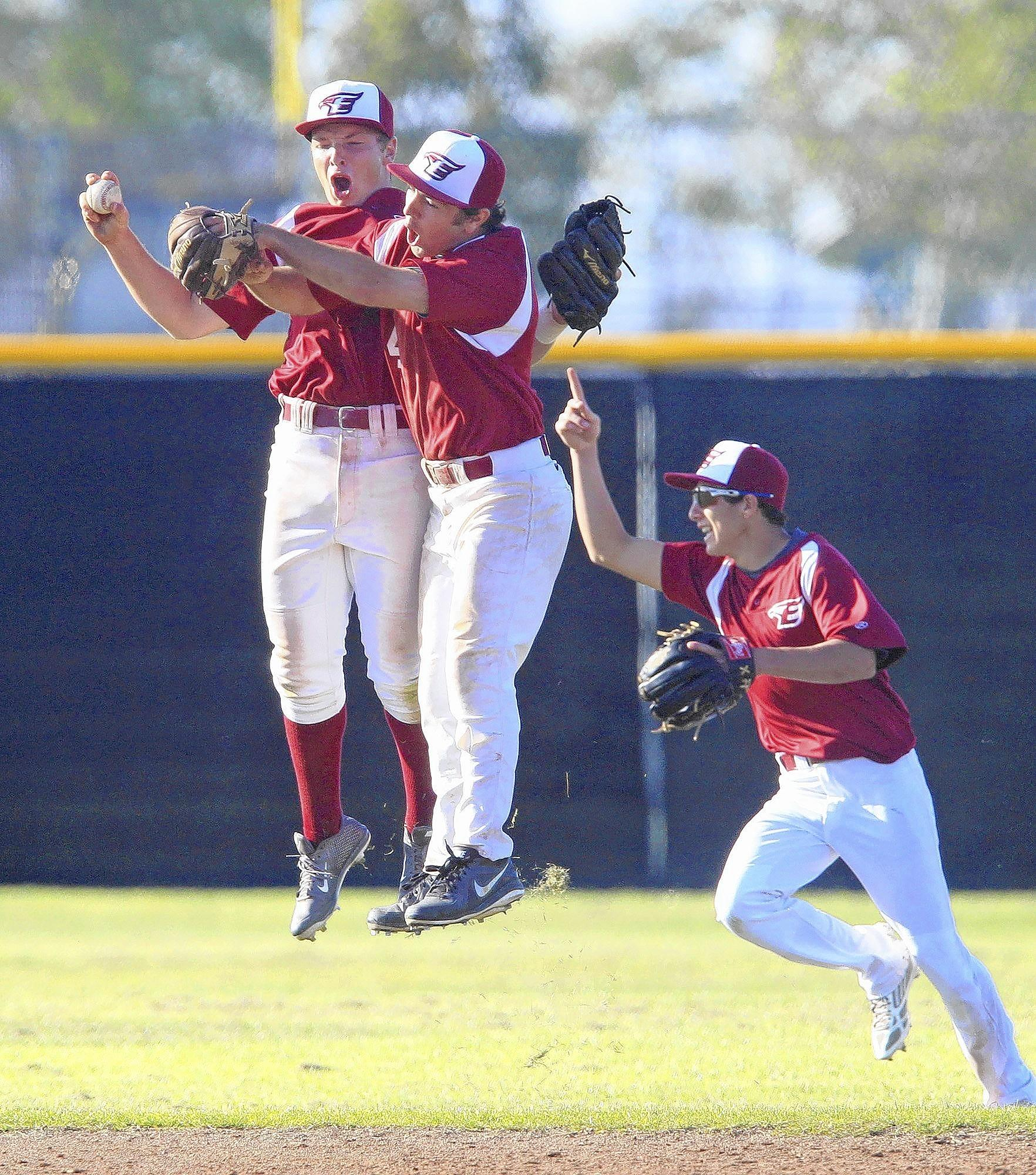 Estancia High's Jackson Letterman, left, Zach Shafer, center, and Dylan Laurent, right, celebrate after Letterman secured the last out to beat Costa Mesa, 2-0, on Wednesday in the second game of a three-game series.