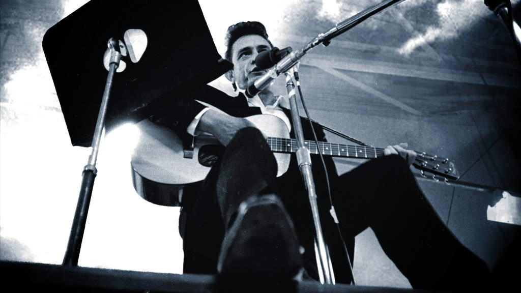 "Singer Johnny Cash in a scene from the movie ""Johnny Cash at Folsom Prison."""