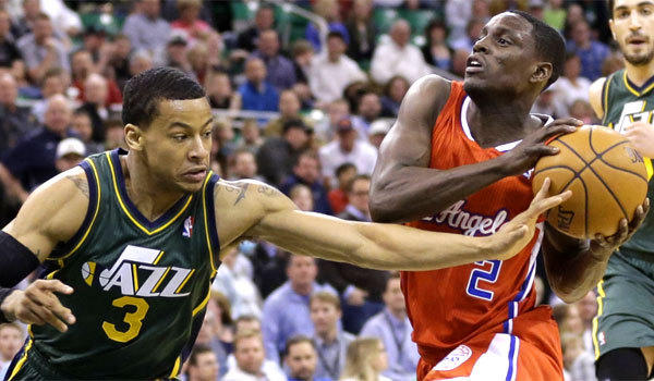 The Clippers' Darren Collison drives to the basket against Utah's Trey Burke on March 14.