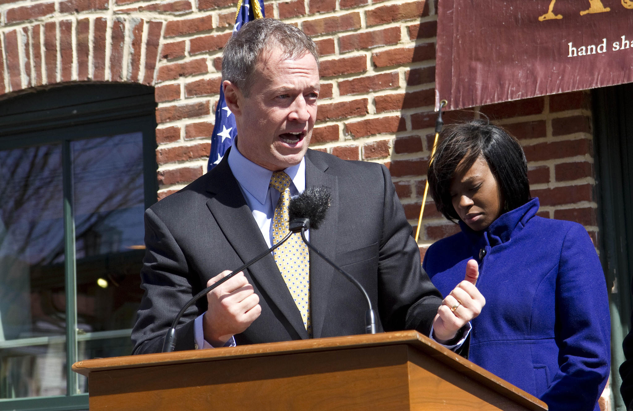 Gov. Martin O'Malley talks to a crowd about raising the minimum wage next to Atwater's Naturally Leavened Bread Bakery and Cafe in Catonsville on Thursday afternoon March 20, 2014.