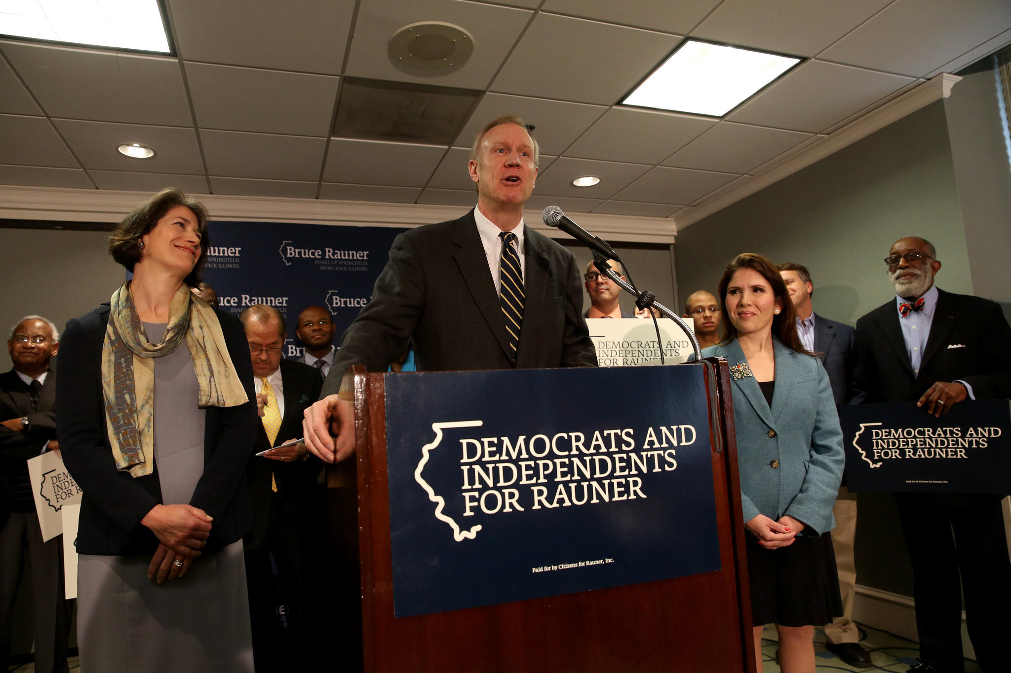 Republican gubernatorial candidate Bruce Rauner, flanked by his wife Diana, left, and running mate Evelyn Sanguinetti, holds a press conference at the Allegro Hotel in Chicago to announce a group of nearly two dozen Democrats and independents backing his campaign.