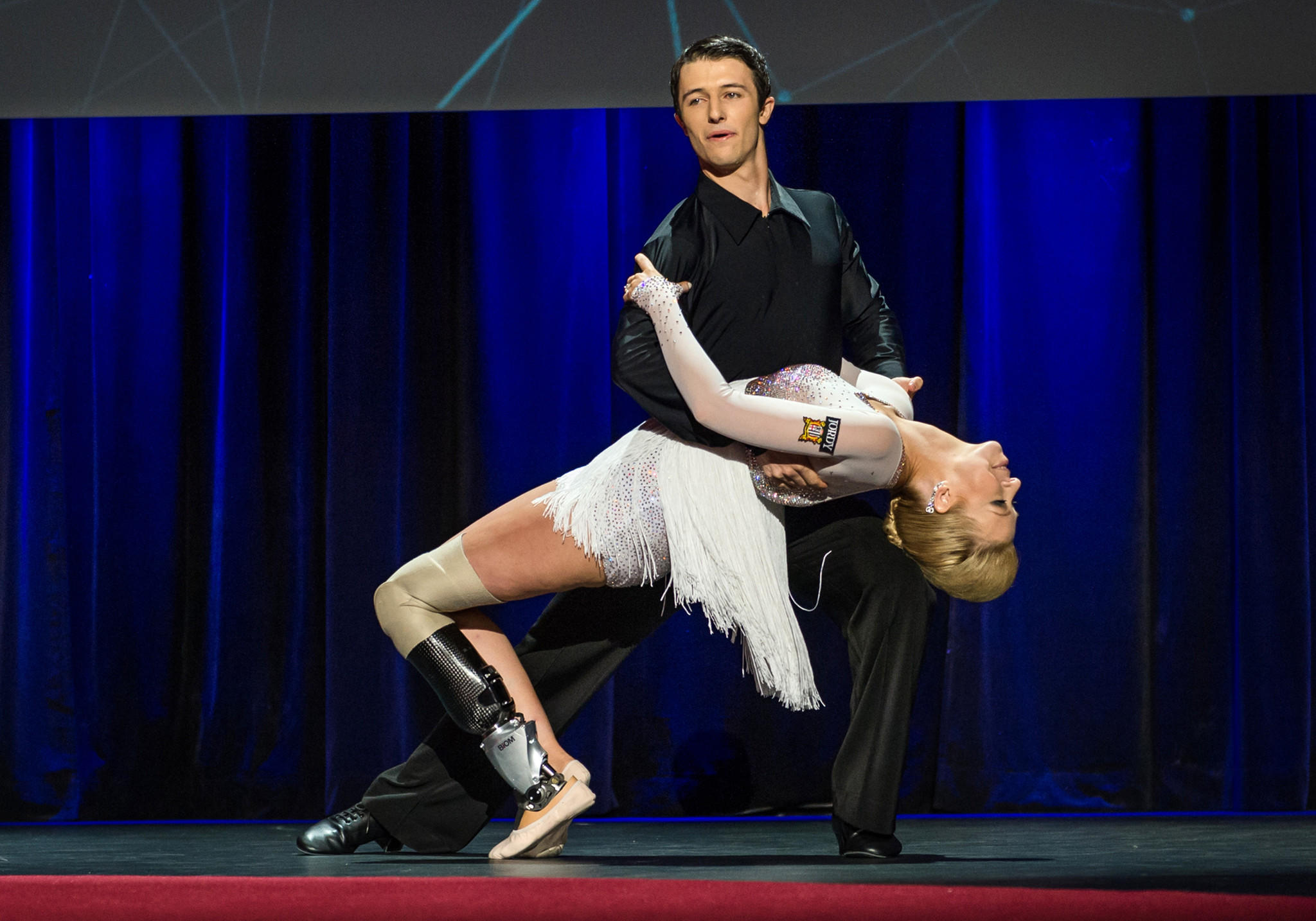 In this photo provided by the TED 2014 Conference, Adrianne Haslet-Davis performs onstage with fellow dancer Christian Lightner in Vancouver, British Columbia.