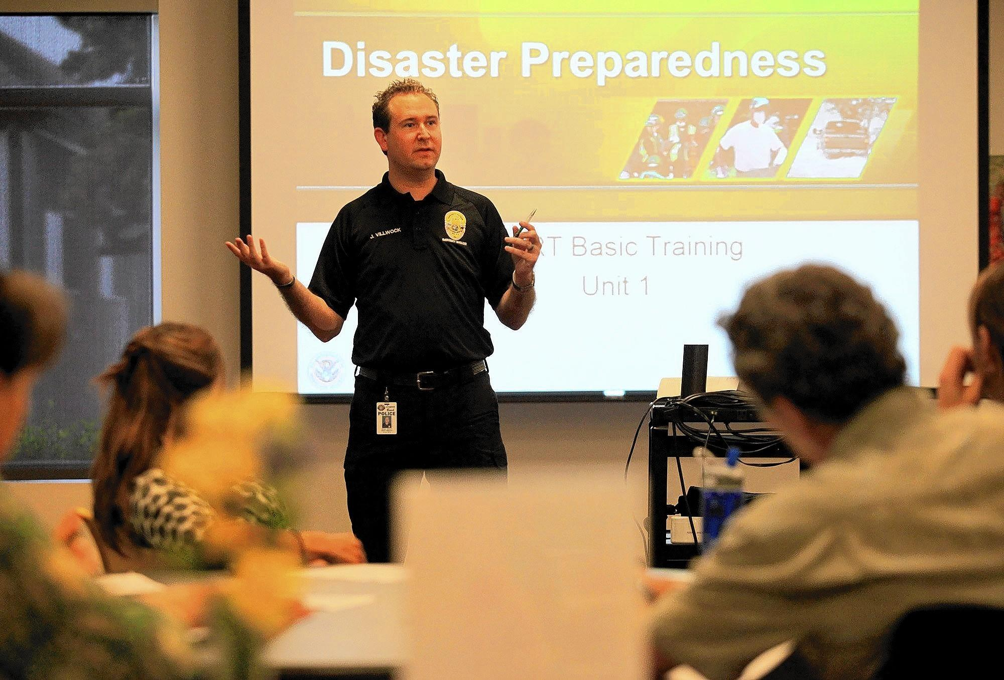 Jordan Villwock, Laguna Beach Police emergency management coordinator, speaks during a Community Emergency Response Team (CERT) class held at the Suzi Q Center in Laguna Beach on Wednesday.