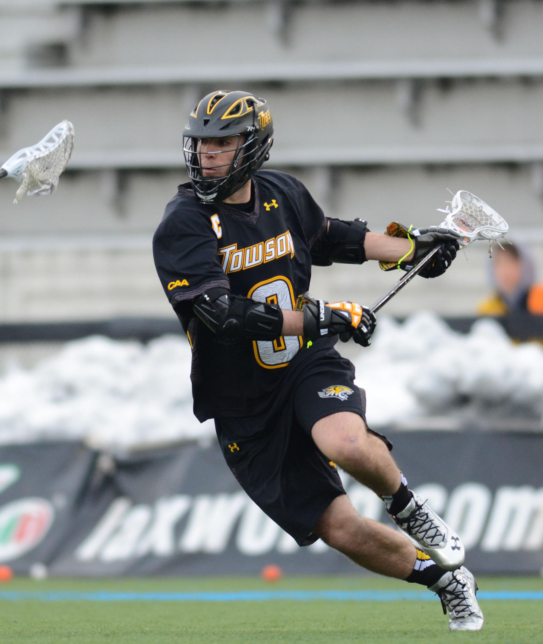 Towson attackman Thomas DeNapoli carries the ball in a 15-8 loss to Johns Hopkins at Homewood Field on Feb. 15.